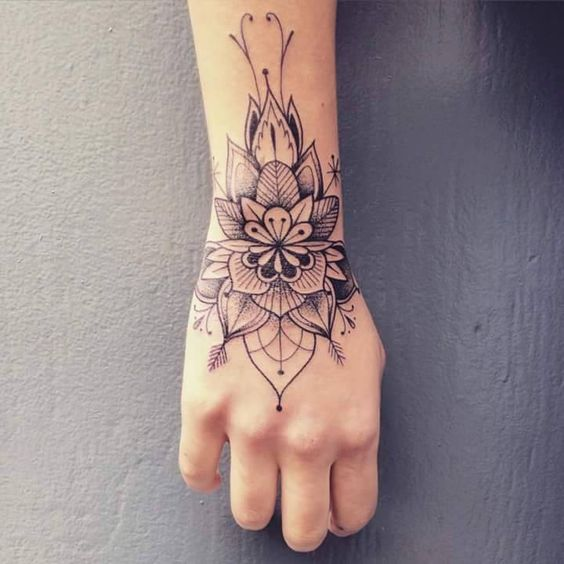 a flower mandala on the wrist and hand