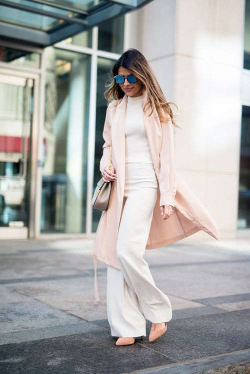 a white top and wide pants, a blush long blazer and heels