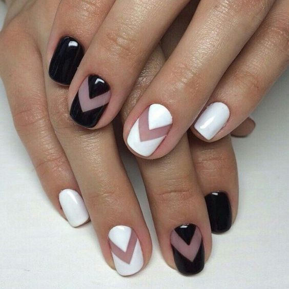 black and white nails with negative space chevron art