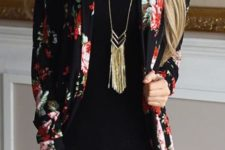 02 distressed jeans, a black top and a black floral blazer
