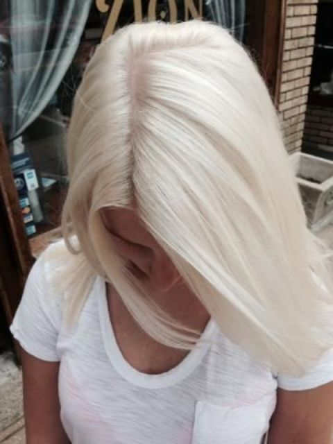 ideal icy blonde solid color on straight hair