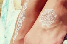 02 if you are going to the beach, try cool white henna foot tattoos