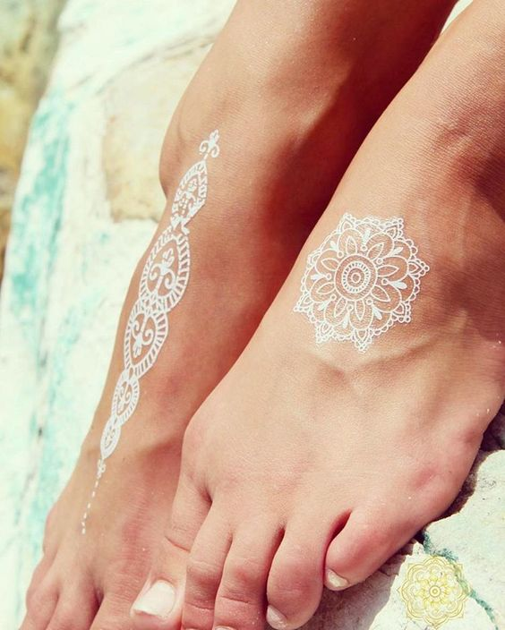 if you are going to the beach, try cool white henna foot tattoos