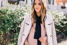 03 a blush mini dress with a black bow and a polka dot white blazer
