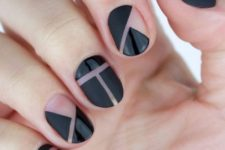 03 black geometric negative space nails with mismatching patterns