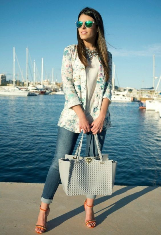 cuffed jeans, a white top, a floral blazer and bold shoes