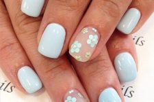 03 powder blue manicure and two accent nails with a matte finish and powder blue flowers
