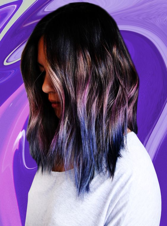 black wavy hair with purple and blue ombre touches