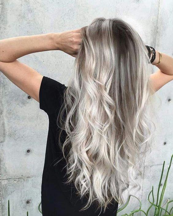 blonde grey and white balayage on darker hair