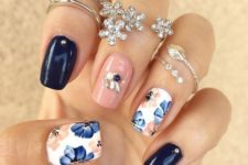 04 navy and peach glossy nails with rhinestones and two floral nails in blue and peach