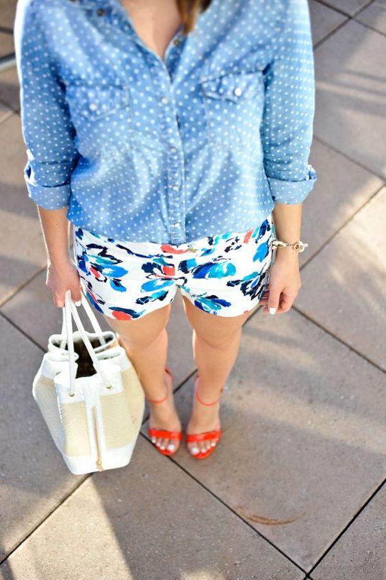 a polka dot chambray shirt, floral shorts and red shoes