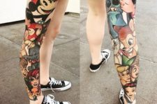 05 a whole leg covered with a colorful Disney-theme tattoo
