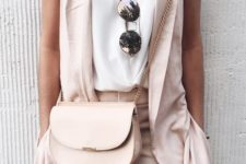 05 blush pants and a long vest, a white top with a V cut