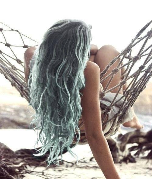 dark hair with light green balayage resembling of sea foam