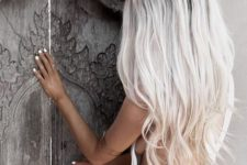 05 long icy blonde hair looks ideal with tanned skin and white nails