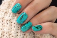 05 turquoise marble nails look very bold