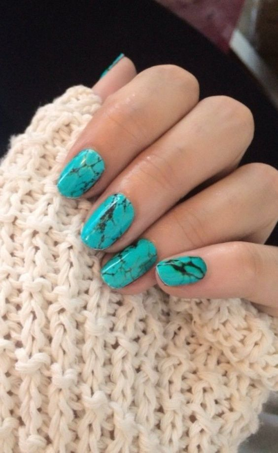 turquoise marble nails look very bold
