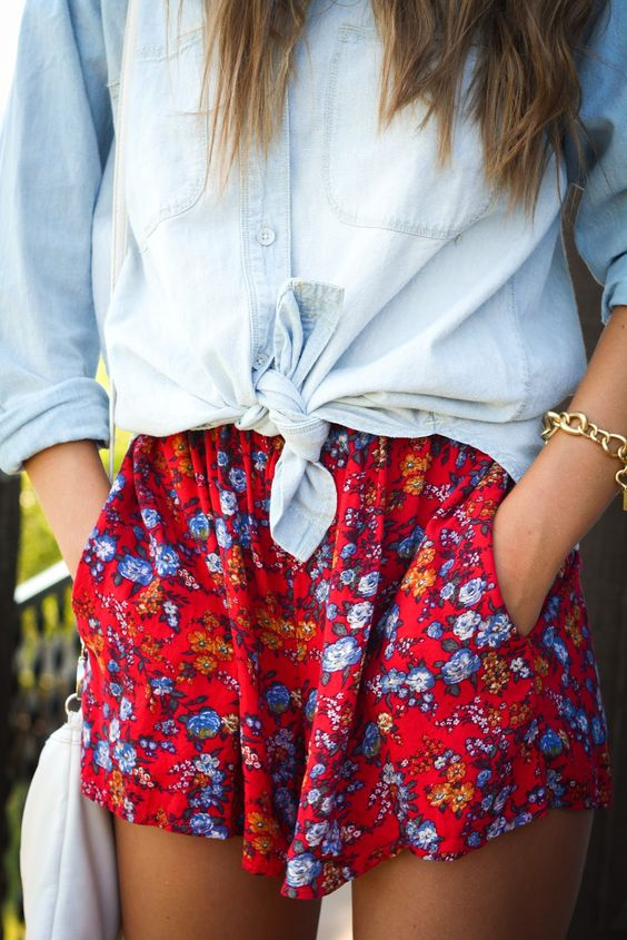 bold red and blue floral shorts, a distressed chambray shirt
