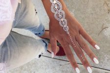 06 chic hand and wrist tattoo with some gold touches