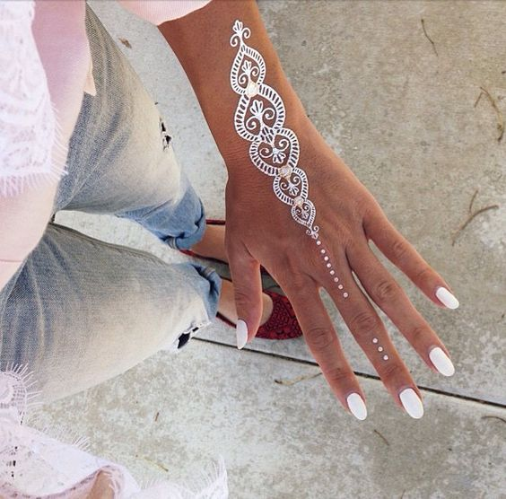 chic hand and wrist tattoo with some gold touches