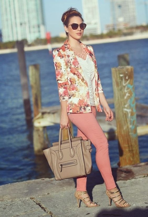 pink pants, a white top, a peach and orange blazer and metallic heels
