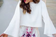 07 a white shirt with long sleeves and purple floral shorts