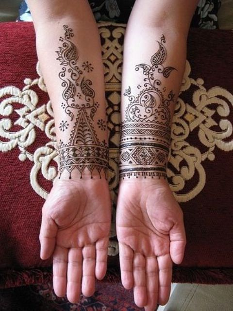 both wrists and arms covered with Moroccan patterns