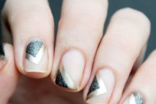 07 floating negative space manicure with gold foil and black glitter