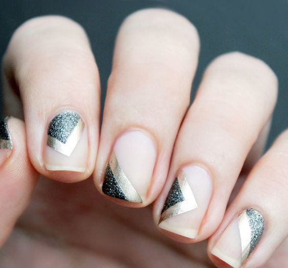 floating negative space manicure with gold foil and black glitter
