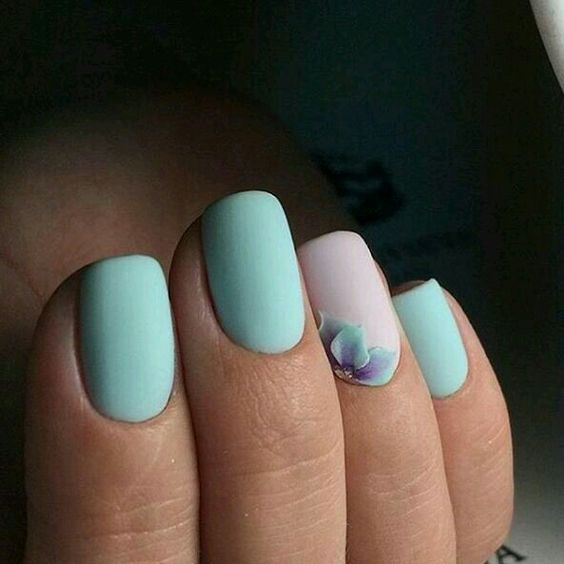 matte mint nails and a blush accent one with a mint dimensional flower
