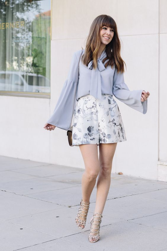 a pale blue shirt, delicate pastel blue shorts and lace up heels