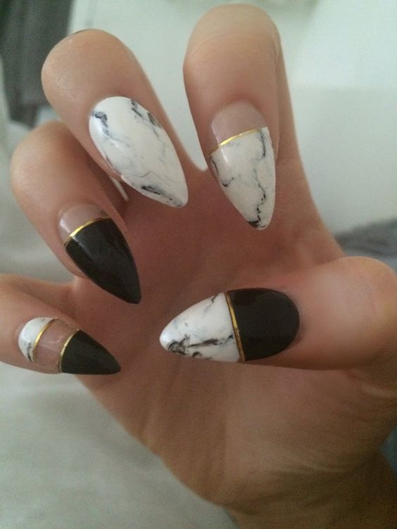 black, gold stripes and white marble nails
