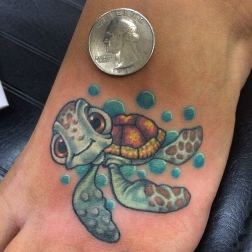 colorful turtle tattoo is small and cool looking