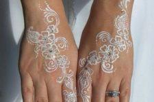 08 flower white henna tattoos on both hands