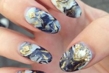 09 black marble nails with gold accents and textural details