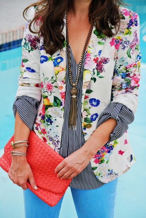bold blue pants, a striped shirt and a bold floral blazer