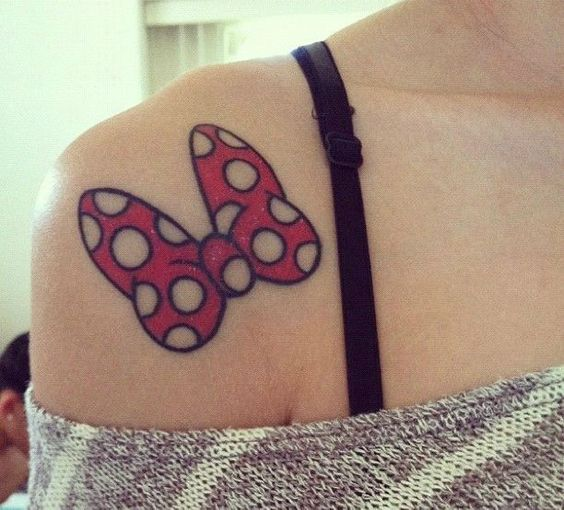 colorful Minnie Mouse bow on a shoulder looks super cute