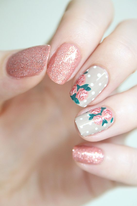 glitter pink nails and two polka dot and pink flower nails