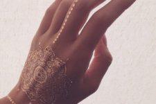 09 gorgeous mandala gold henna tattoo on the hand, finger and wrist