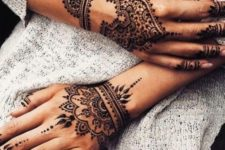 09 lovely henna patterns on both hands, wrists and fingers