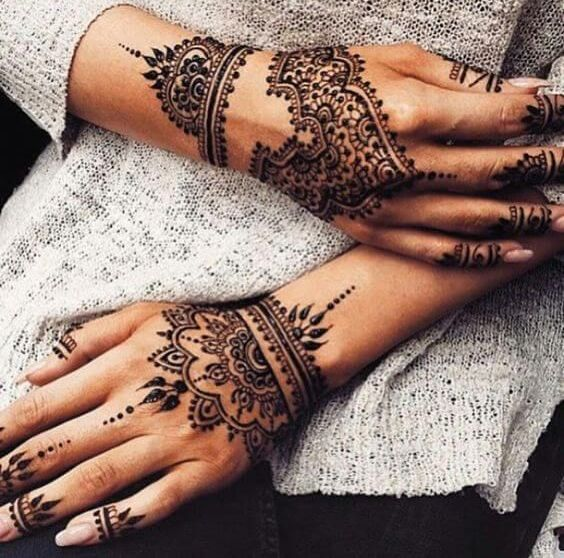 lovely henna patterns on both hands, wrists and fingers