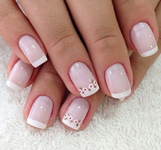 French nails with delicate flowers on just two nails