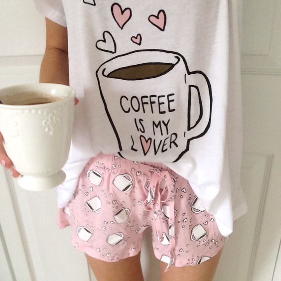 a cool pjs with pink shorts and a coffee mug print and a white printed tee