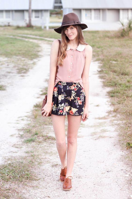 black floral shorts, a blush shirt and brown vintage shoes