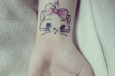 10 cute kittie wrist tattoo for a lady