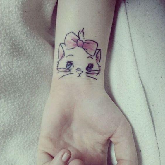 cute kittie wrist tattoo for a lady