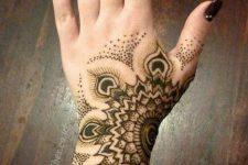 10 half mandala with feathers tatoto on a wrist and hand