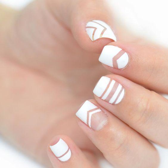 white chevron and stripes negative space nail art