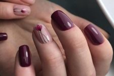 11 burgundy manicure with just one blush and red flower accent