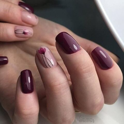 burgundy manicure with just one blush and red flower accent
